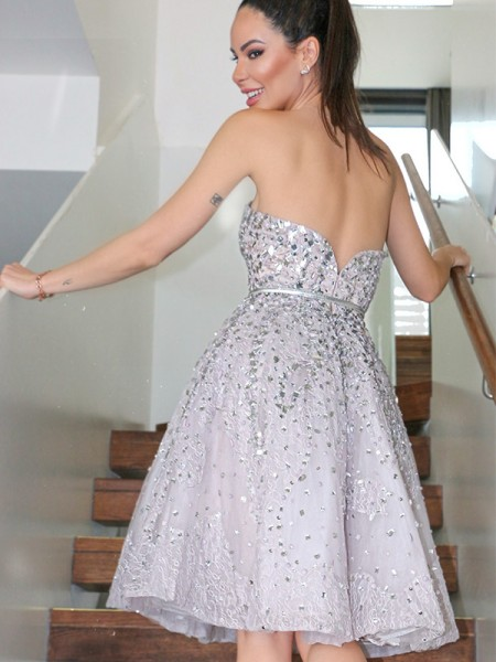 A-Line/Princess Strapless Sleeveless Sequin Knee-Length Tulle Homecoming Dresses